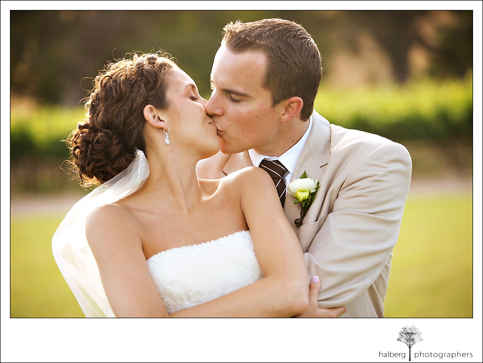 marisa and lane kiss at their fess parker winery wedding in Santa Ynez Valley