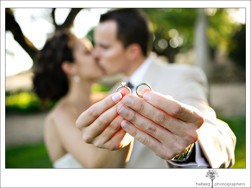 marisa and lane show off their wedding rings at their fess parker winery wedding