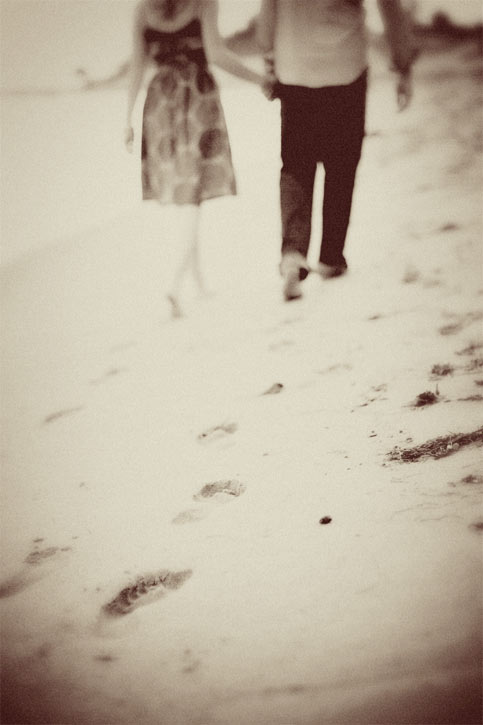 Walking down the beach in Malibu - wedding photography engagement session
