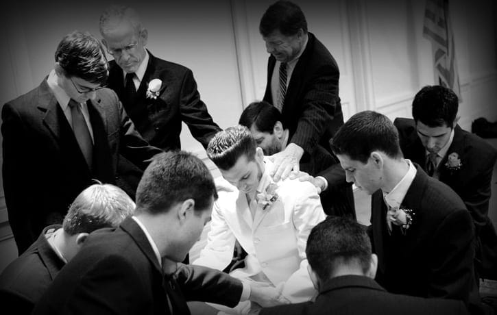 Wedding prayers over Kevin were beautiful for wdding photography