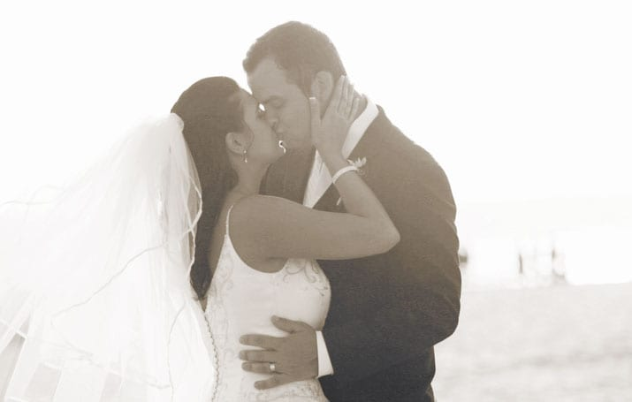 Gina and Garrett kiss after their Hotel Del Coronado Wedding