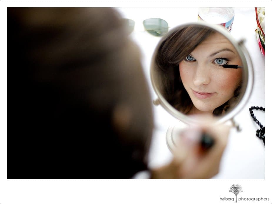 Darcy putting on her makeup at Hotel Bellwether