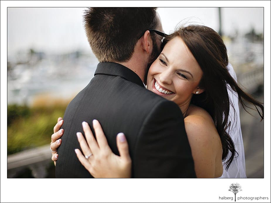 Steve and Darcy embrace after first look at their Hotel Bellwether Wedding