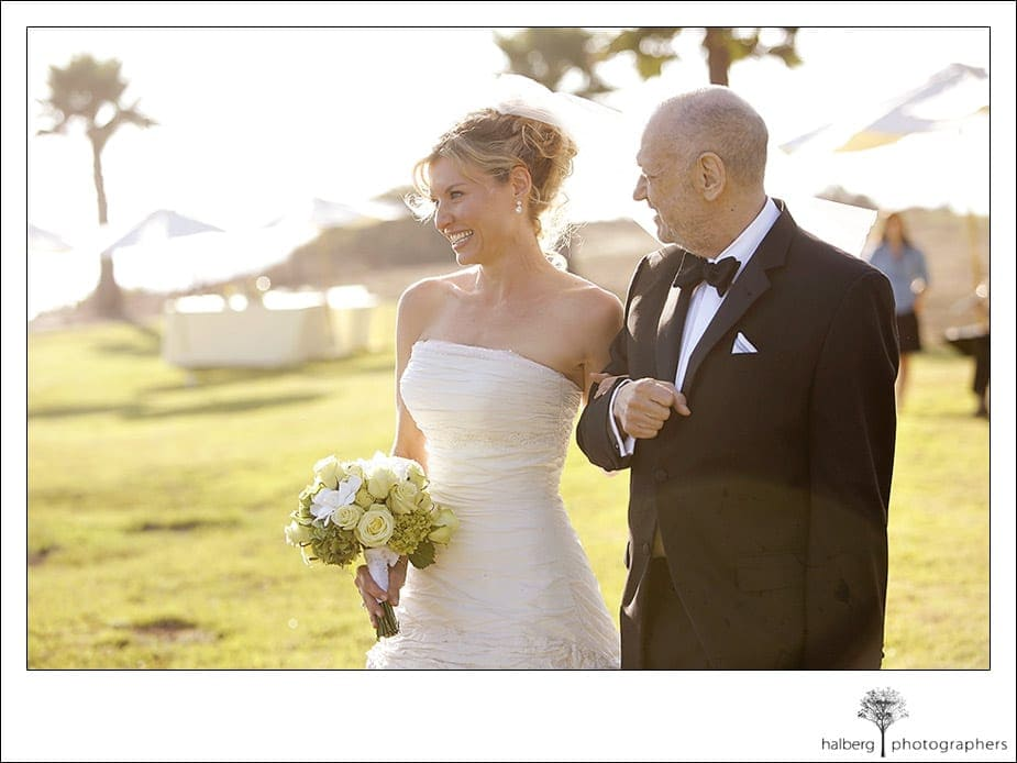 Victoria's father walking her down the isle at Dos Pueblos Ranch wedding