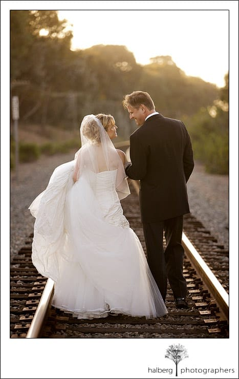 Jeff and Victoria walking on railroad tracks after their Dos Pueblos Ranch Wedding