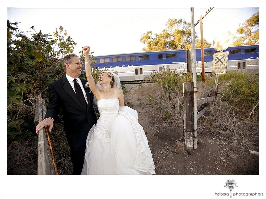 Jeff and Victoria cheer as train goes by the Dos Pueblos Ranch