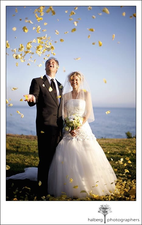 Flowers are tossed at Jeff and Victoria after their Dos Pueblos Ranch wedding