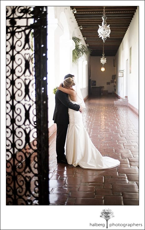 John and Jennifer embrace at their Santa Barbara Courthouse wedding