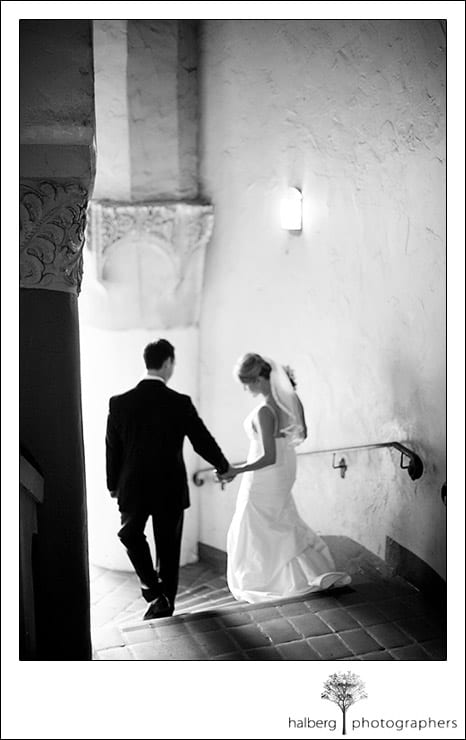 John and Jennifer walk down stairs at their Santa Barbara Courthouse wedding