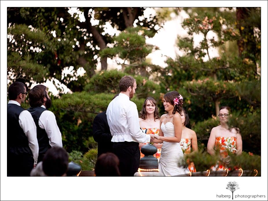 Bride and groom exchanging vows at earl burns Japanese garden wedding