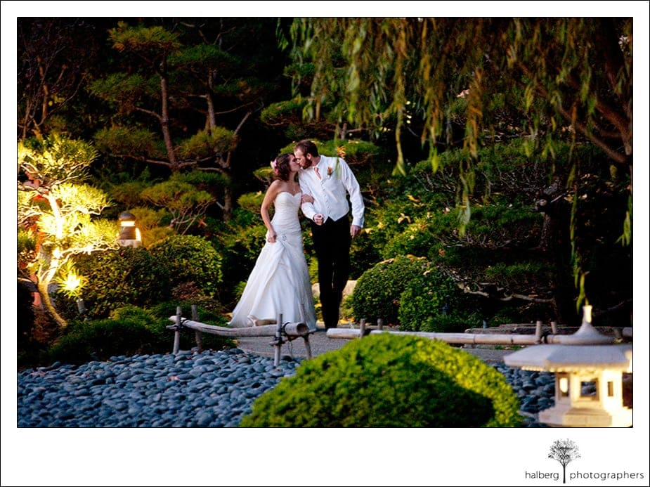 bride and groom kiss at earl burns japanese garden wedding