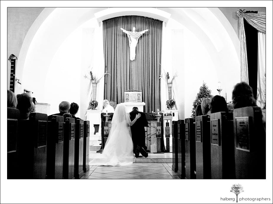 bride and groom at alter of Our Lady of Solitude Parish