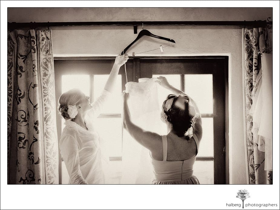 bride and maid of honor getting ready at chateau julien wine estate