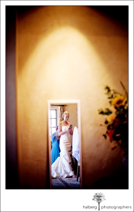 image of bride in mirror getting ready at chateau julien wine estate