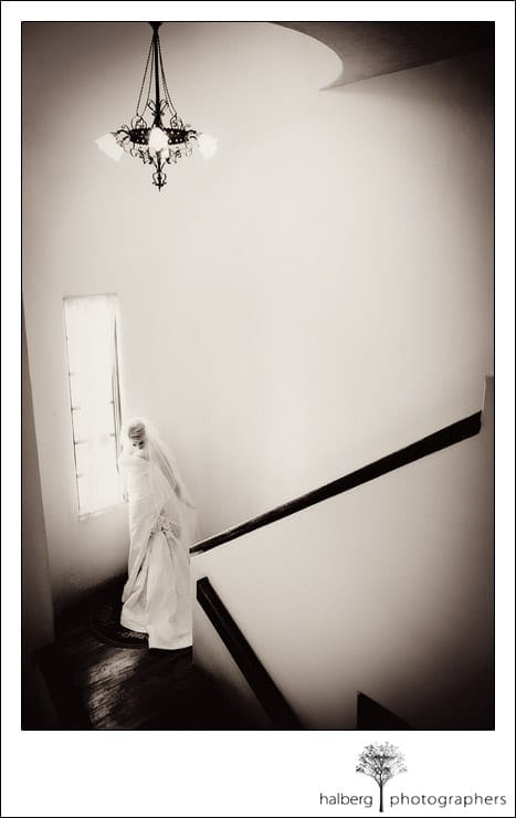 bride walking down stairs at chateau julien wine estate