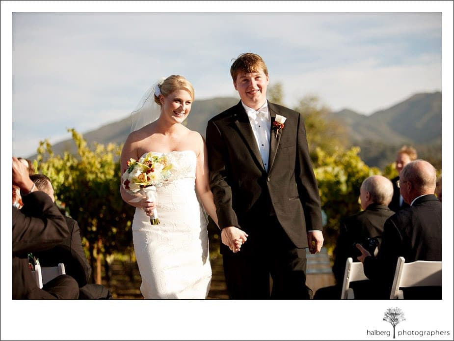 bride and groom wedding recessional at chateau julien wine estate