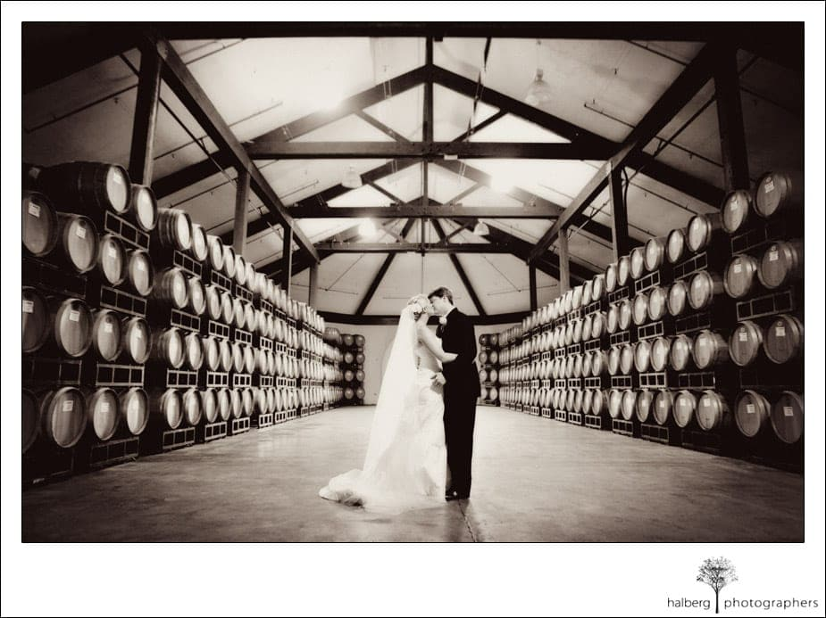 bride and groom portraits in barrel room chateau julien wine estate