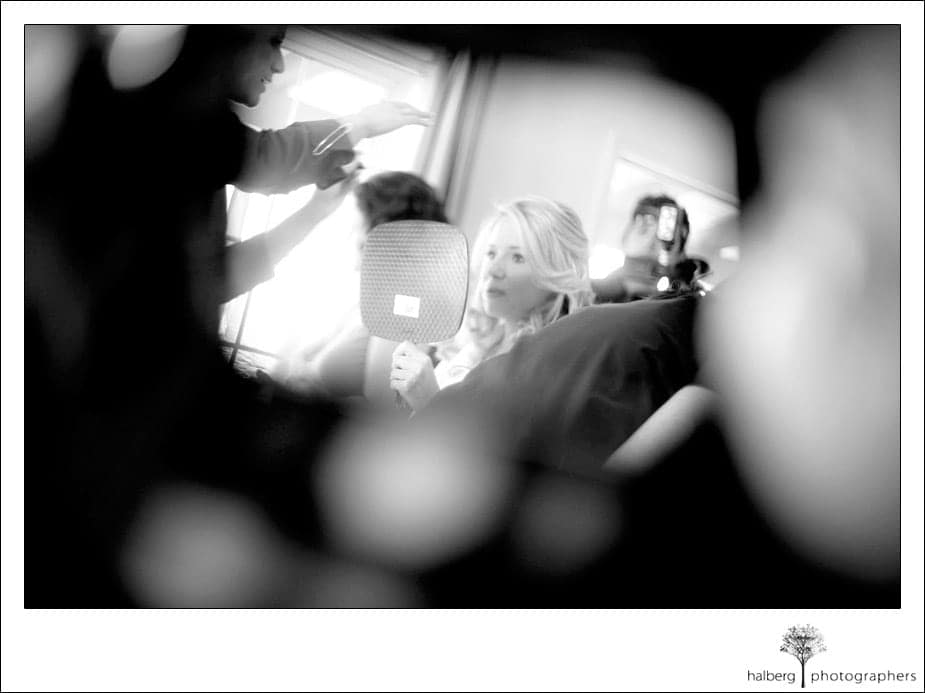 bride getting ready for her wedding at stella mare's restaurant