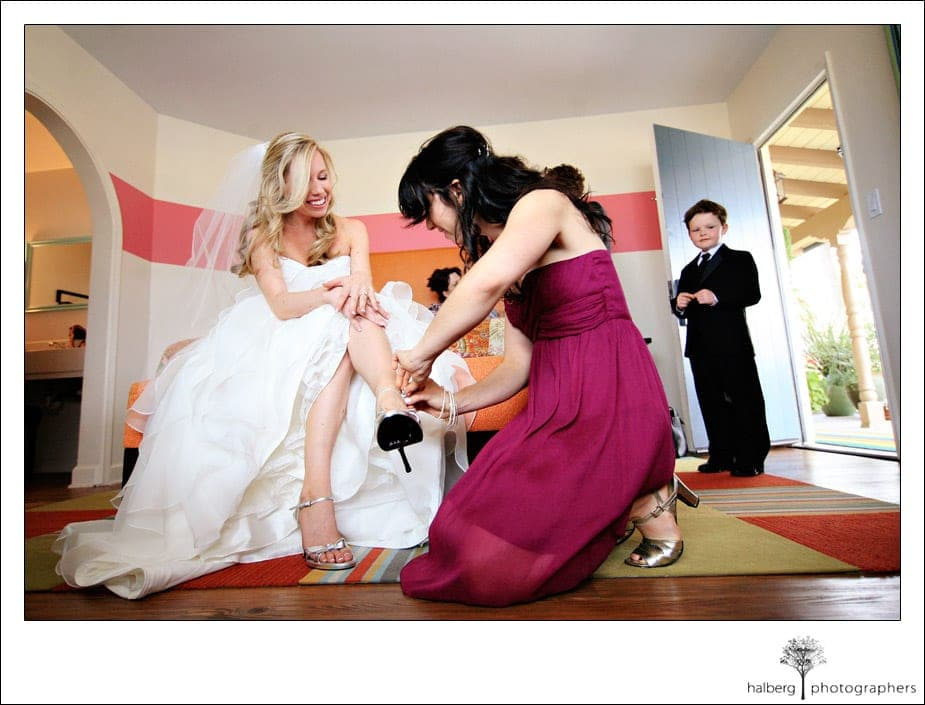 bride putting wedding shoes on
