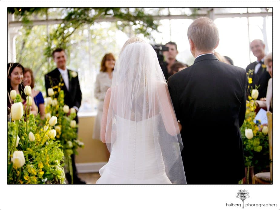 father walking bride down the isle at her stella mare's restaurant wedding