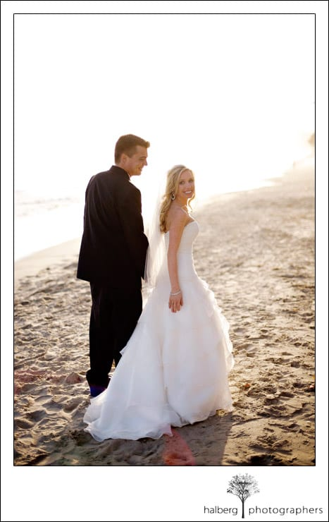 bride and groom walking at butterfly beach