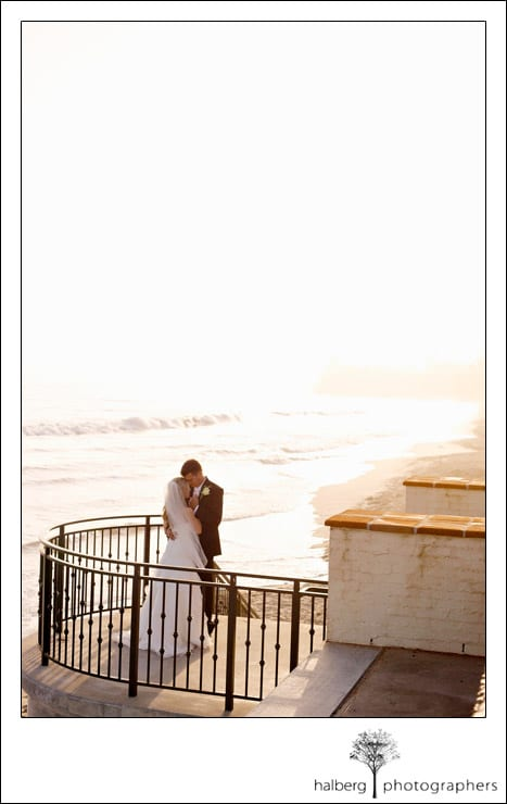 bride and groom portraits on steps at butterfly beach