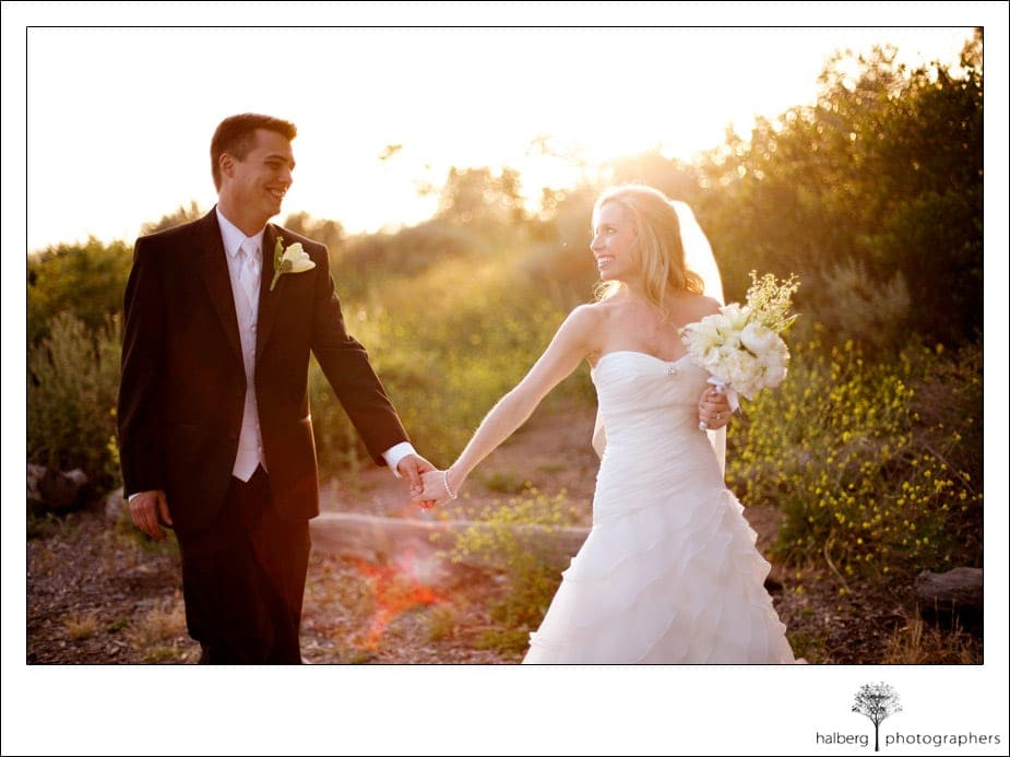 bride and groom walking at bird refuge in front of stella mare's