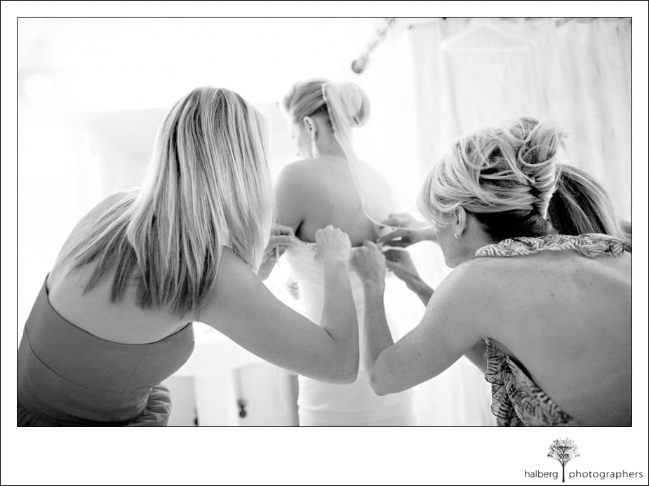 bride putting her wedding dress on at charles krug winery