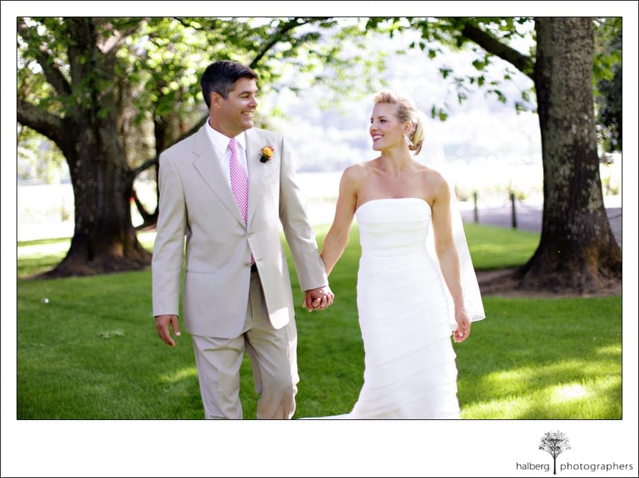 bride and groom walking together at charles krug winery