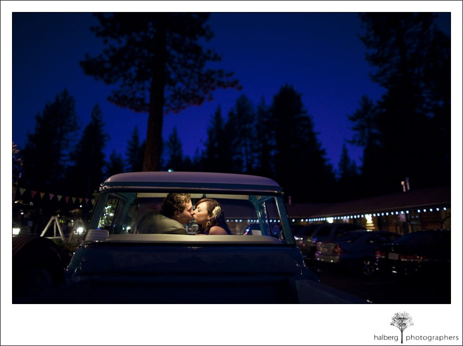 bride and groom kissing in car at fireside lodge lake tahoe