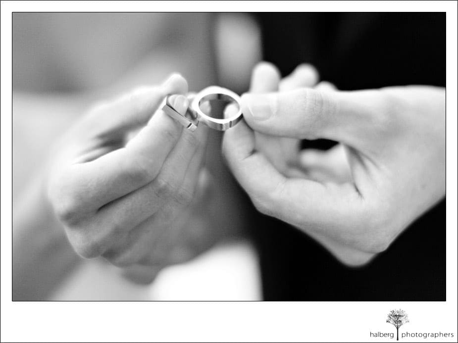 Bride And Groom Holding Their Custom Wedding Rings