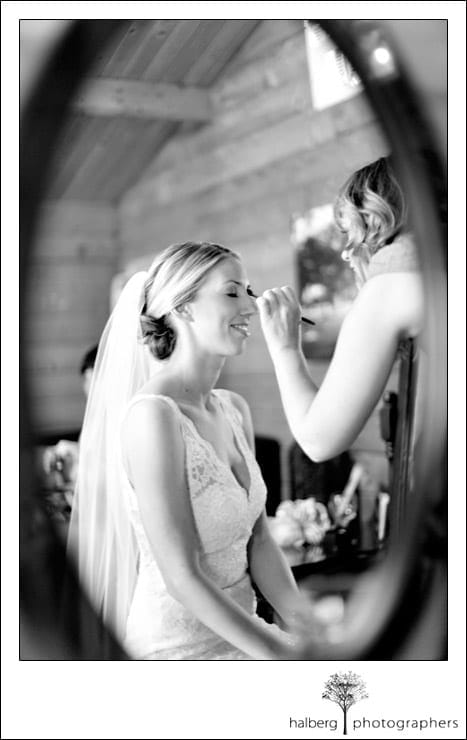bride getting last minute touch ups at her walnut grove wedding