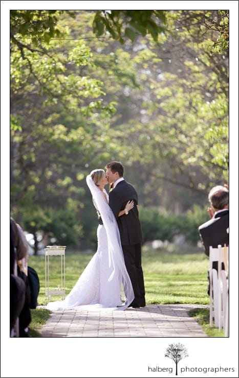 bride and groom kissing at their walnut grove wedding