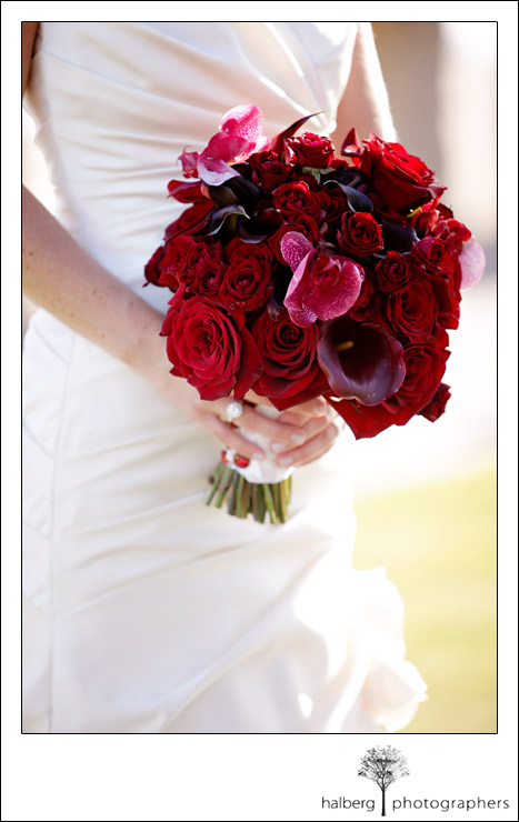 bridal bouquet of red roses, orchids and calla lilies