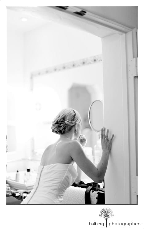 bride putting on finishing touches of her makeup at four seasons biltmore wedding