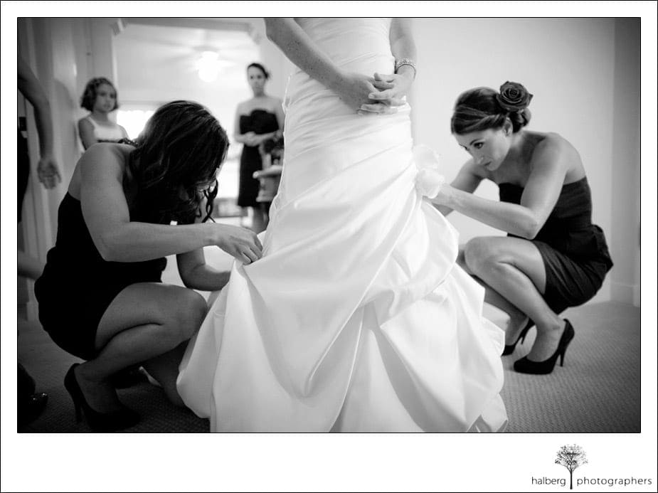 bridesmaids helping bride with wedding gown train at four seasons biltmore