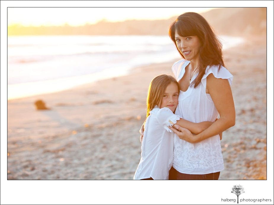 mother and daughter hugging at private beach in hope ranch