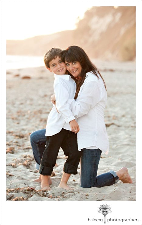 mother hugging son at private beach in hope ranch