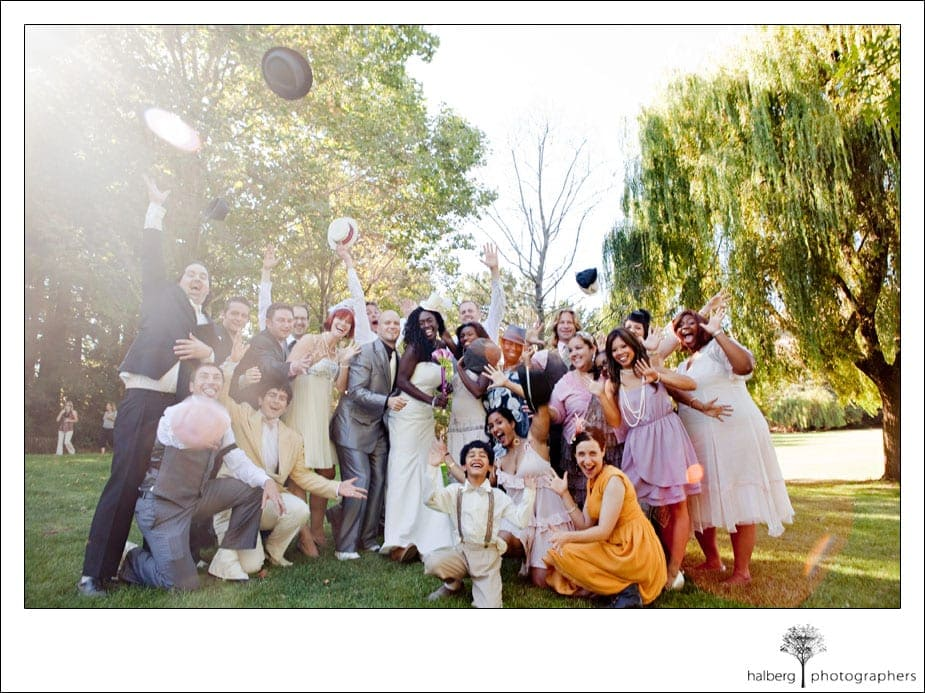prohibition themed bridal party throwing hats in the air at san francisco wedding