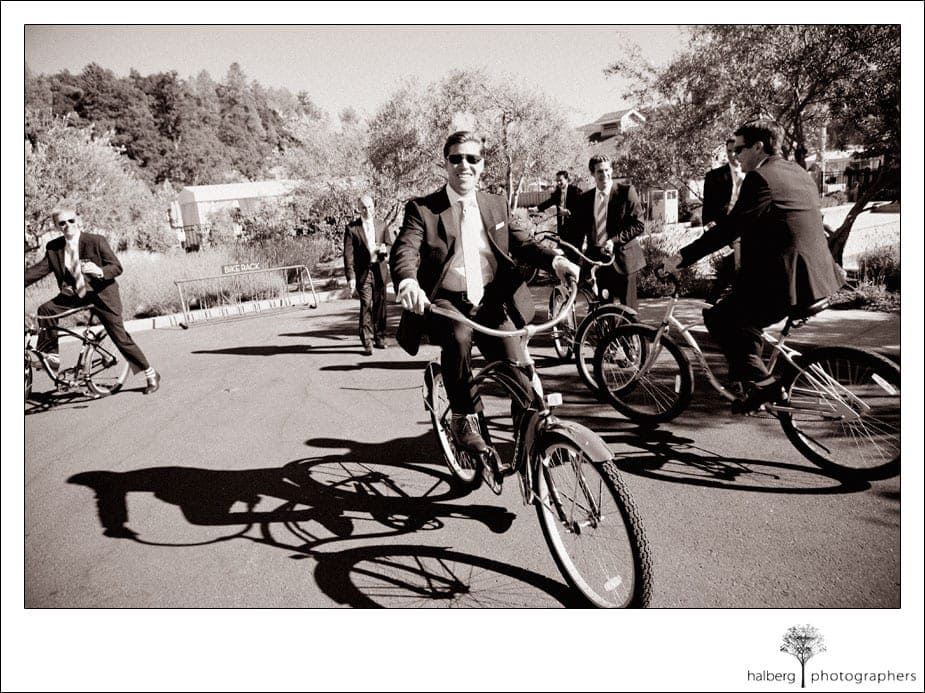 groom riding on solage bikes before his wedding