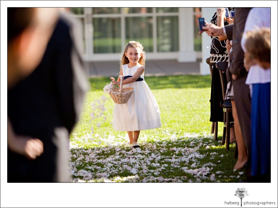 flower girl walking down isle at solage wedding