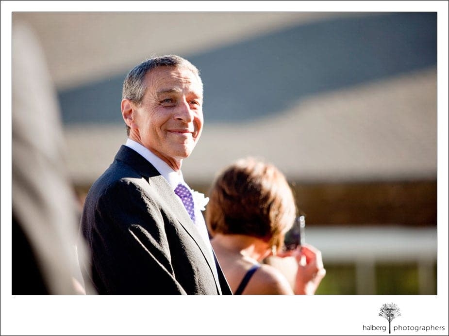 father of groom looking on at solage wedding ceremony