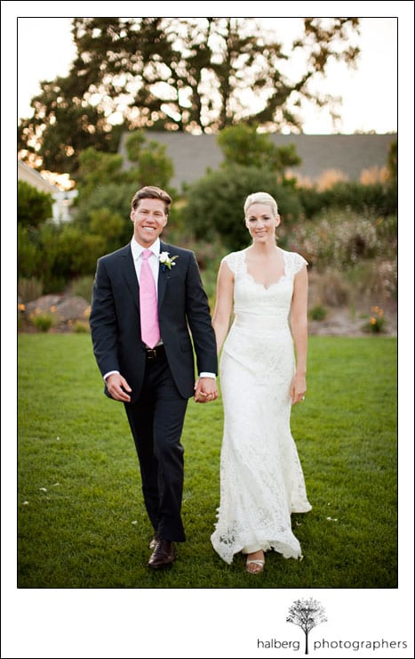 bride and groom walking holding hands at solage wedding