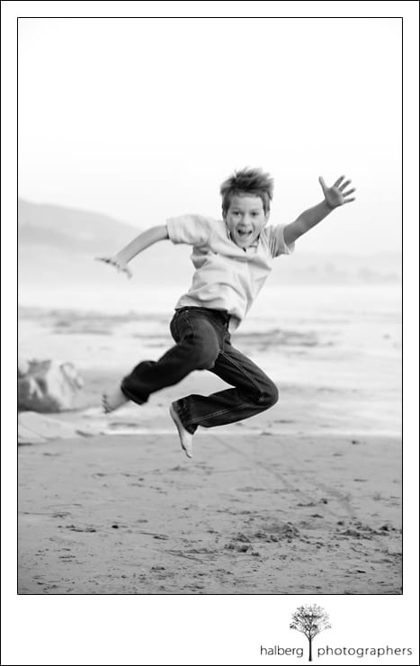 Bleecker son jumping on beach in santa barbara