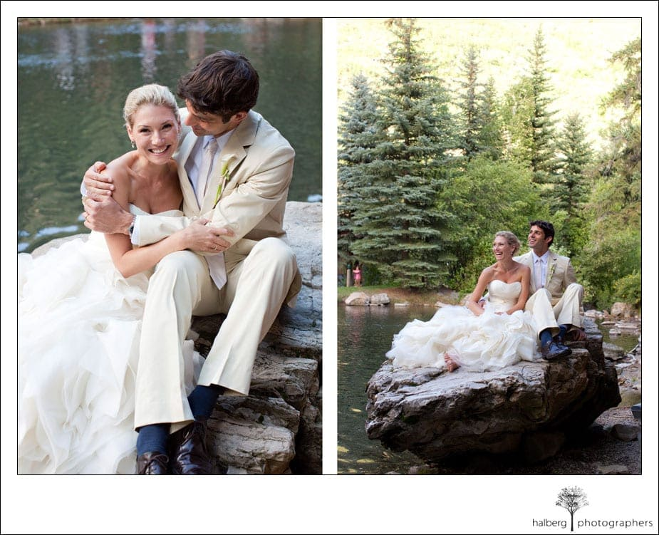 bride and groom on rock in front of pond at sundance wedding