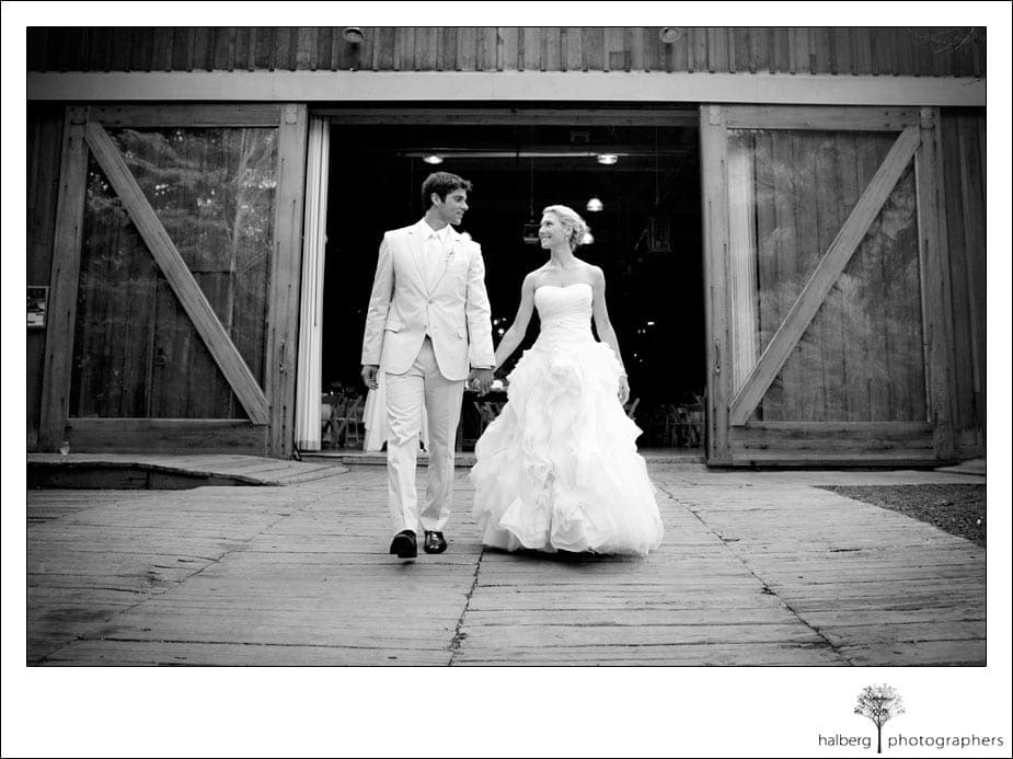 bride and groom in front of wedding reception at sundance resort