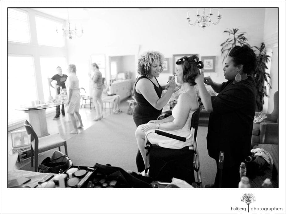 bride having make up and hair done for her wedding