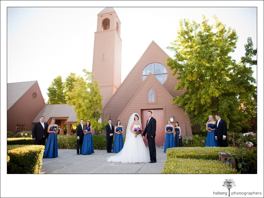 bride and groom with bridal party in front of church wedding