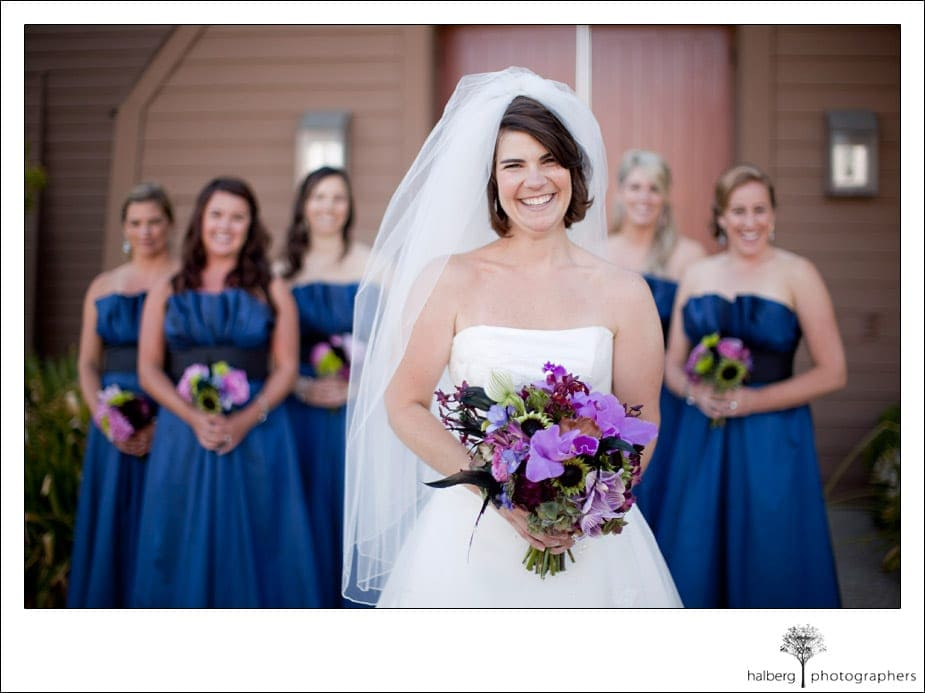 portrait of bride and bridesmaids in front of church