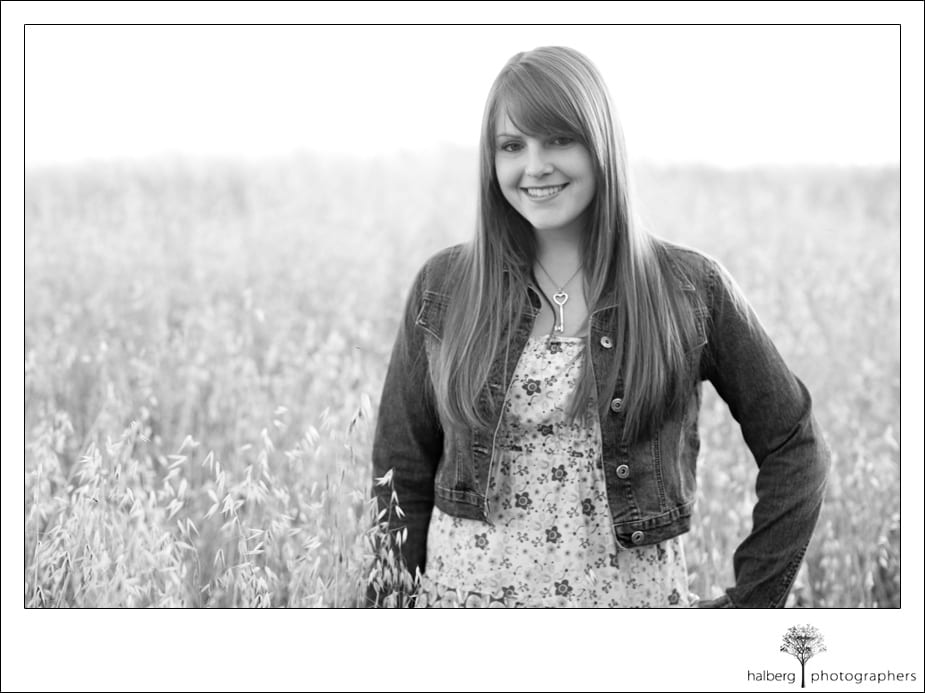 Senior portrait in field of tall grass